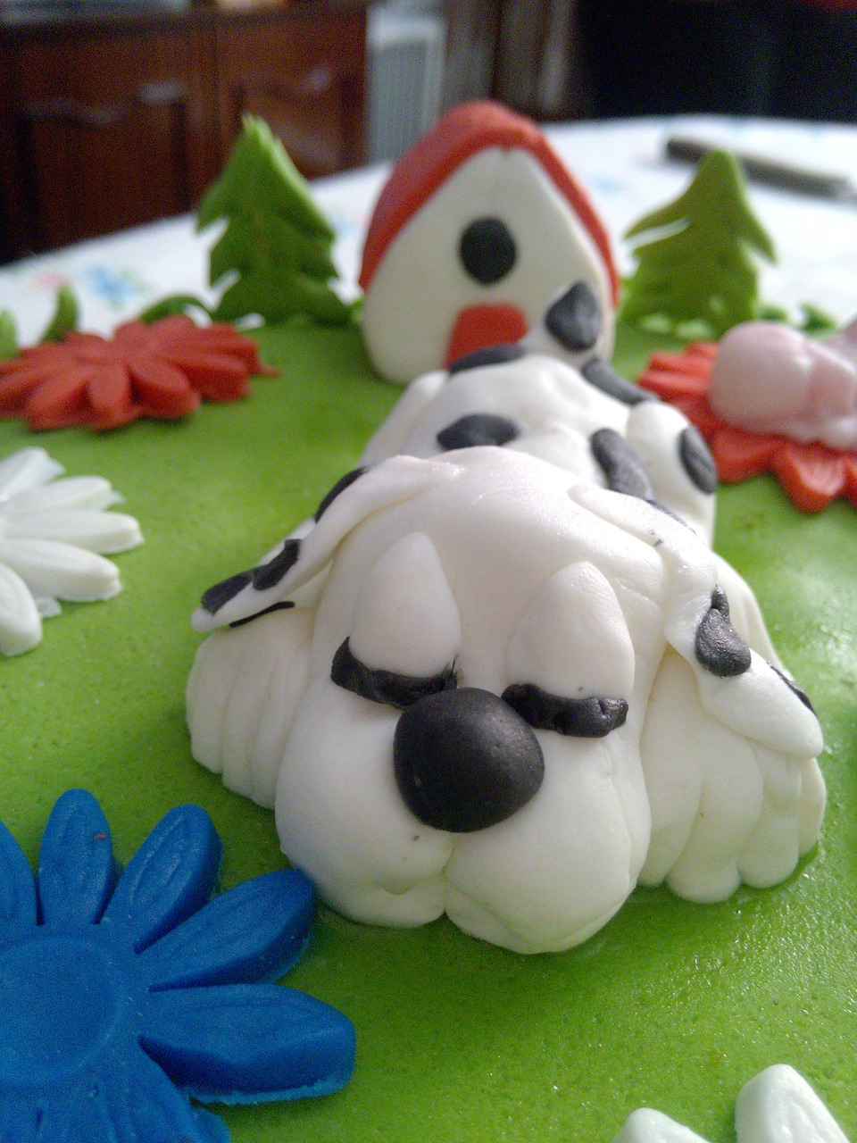 a cake topped with dog-shaped fondant